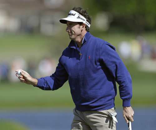 Gonzalo Fenandez Castano, of Spain, holds up his ball after sinking a birdie putt on the sixth hole during the final round of the Arnold Palmer Invitational golf tournament, Monday, March 25, 2013, in Orlando, Fla. (AP Photo/John Raoux)