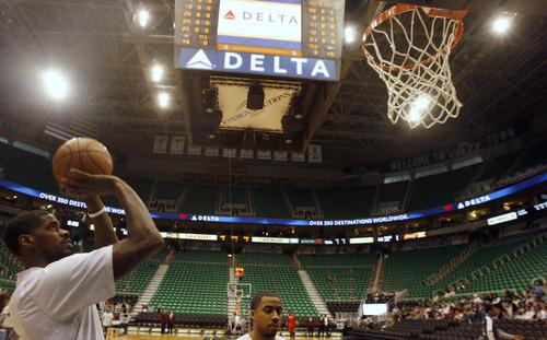 Rick Egan  | The Salt Lake Tribune   Utah Jazz power forward Marvin Williams (2) shoots photos during warm ups before the Jazz faced the Philidelphia, 76'ers,  Monday, March 25, 2013.