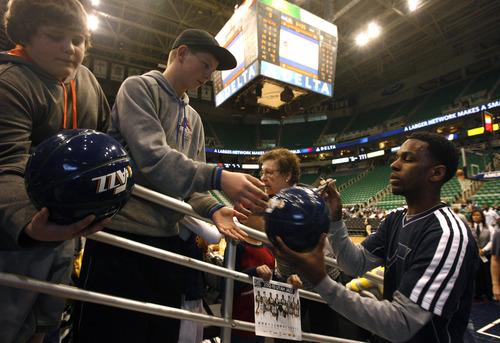 Rick Egan  | The Salt Lake Tribune   Utah Jazz shooting guard Kevin Murphy (55) signs autographs before the Jazz faced the Philidelphia, 76'ers,  Monday, March 25, 2013.