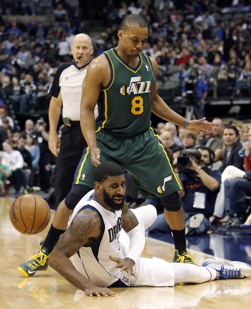 Utah Jazz guard Randy Foye (8) fouls Dallas Mavericks' guard O.J. Mayo (32) during the second half of an NBA basketball game,n Sunday, March 24, 2013, in Dallas. Dallas won 113-108. (AP Photo/Brandon Wade)