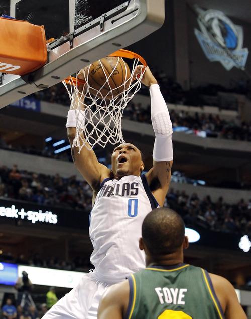 Dallas Mavericks' forward Shawn Marion (0) dunks as Utah Jazz guard Randy Foye (8) watches during the second half of an NBA basketball game, Sunday, March 24, 2013, in Dallas. Dallas won 113-108. (AP Photo/Brandon Wade)