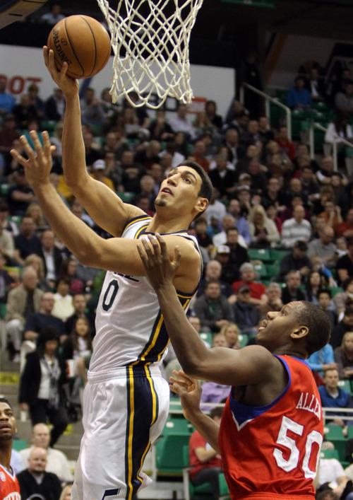 Rick Egan    The Salt Lake Tribune   Utah Jazz center Enes Kanter (0) shoots over Philadelphia 76ers center Lavoy Allen (50), in NBA action, Jazz vs. the Sixers, at EnergySolutions Arena, Monday, March 25, 2013.