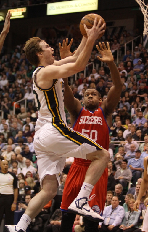 Rick Egan  | The Salt Lake Tribune   Utah Jazz shooting guard Gordon Hayward (20) goes in for a lay up, as Philadelphia 76ers center Lavoy Allen (50) defends,  in NBA action, Jazz vs. the Sixers, at EnergySolutions Arena, Monday, March 25, 2013.