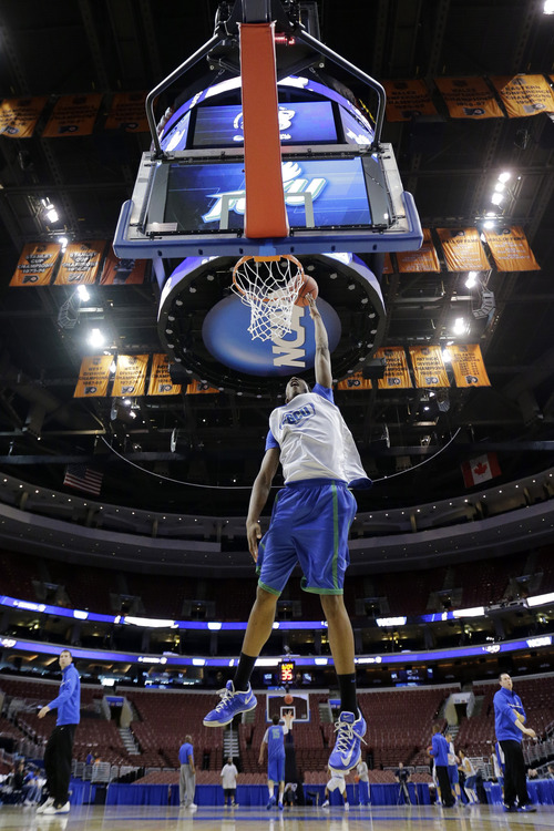 Florida Gulf Coast's Eric McKnight goes up for a dunk during practice for a second-round game of the NCAA college basketball tournament, Thursday, March 21, 2013, in Philadelphia. Florida Gulf Coast is scheduled to play Georgetown on Friday. (AP Photo/Matt Slocum)