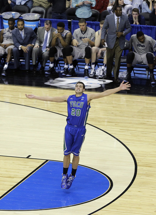 Florida Gulf Coast's Chase Fieler celebrates in the final seconds of a second-round game against Georgetown in the NCAA college basketball tournament on Friday, March 22, 2013, in Philadelphia. Florida Gulf Coast won 78-68. (AP Photo/Matt Slocum)