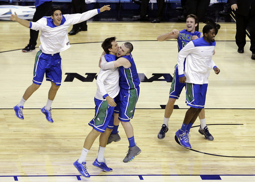 Florida Gulf Coast players celebrate after winning a second-round game against Georgetown 78-68 in the NCAA college basketball tournament on Friday, March 22, 2013, in Philadelphia. (AP Photo/Matt Slocum)