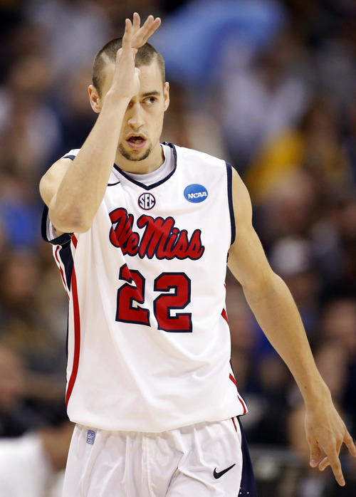 Mississippi guard Marshall Henderson (22) celebrates a 3-pointer during the first half of a third-round game against La Salle in the NCAA college basketball tournament at the Sprint Center in Kansas City, Mo., Sunday, March 24, 2013. (AP Photo/Orlin Wagner)