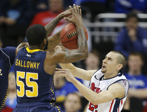 La Salle guard Ramon Galloway (55) blocks a pass by Mississippi guard Marshall Henderson (22) during the first half of a third-round game in the NCAA college basketball tournament at the Sprint Center in Kansas City, Mo., Sunday, March 24, 2013. (AP Photo/Orlin Wagner)