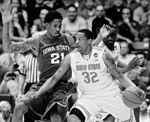 Ohio State guard Lenzelle Smith, Jr. (32) drives against Iowa State guard Will Clyburn (21) in the first half of a third-round game of the NCAA college basketball tournament  Sunday March 24, 2013, in Dayton, Ohio. (AP Photo/Al Behrman)