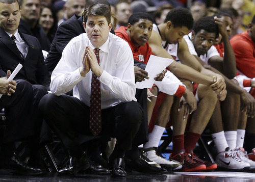 UNLV head coach Dave Rice watches the second half of a second-round game in the NCAA college basketball tournament against California in San Jose, Calif., Thursday, March 21, 2013. California won 64-61. (AP Photo/Jeff Chiu)