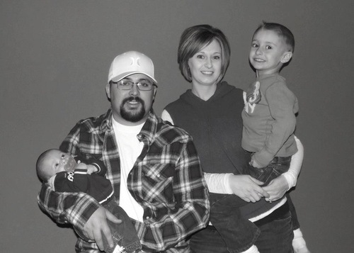 Coal miner Dallen McFarlane is seen here with his family in this undated photo. McFarlane, 26, was injured in an accident March 22, 2013, at the Rhino coal mine in Emery County.