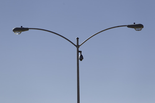 Trent Nelson  |  The Salt Lake Tribune A surveillance camera mounted on a streetlight in Hildale, Utah. Monday, February 18, 2013.