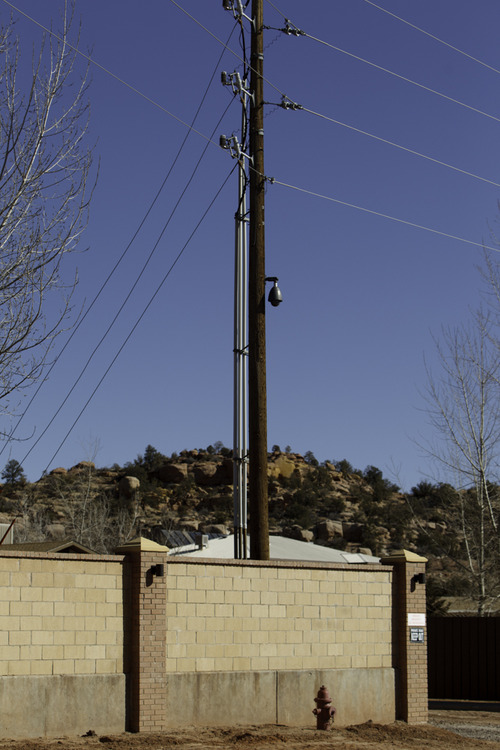 Trent Nelson  |  The Salt Lake Tribune A surveillance camera mounted on what appears to be a public utility pole in Hildale, Utah. Monday, February 18, 2013.