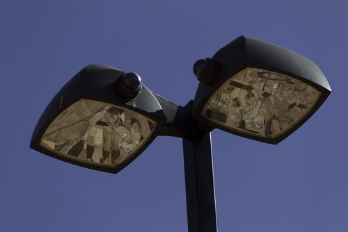 Trent Nelson  |  The Salt Lake Tribune Two surveillance cameras mounted on streetlight in Hildale, Utah. Monday, February 18, 2013.