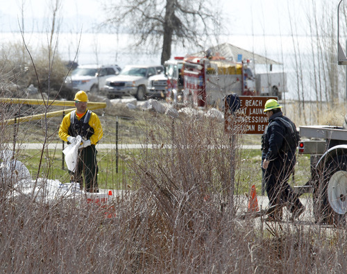 Al Hartmann  |  The Salt Lake Tribune Workers with booms and absorbent material contain a leak from a Chevron pipeline in a wetland area between Willard Bay North Marina and I-15 Tuesday March 19. The leak was detected Monday. Authorities said the leak was contained in retaining ponds and none went into Willard Bay.