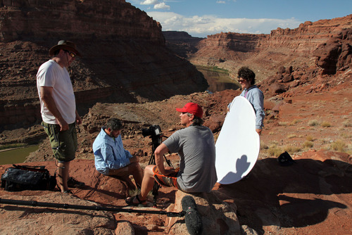 Francisco Kjolseth  |  The Salt Lake Tribune Setting up a shot for KUED high above the Colorado river, audio engineer Kevin Sweet, Tribune reporter Brett Prettyman, videographer Gary Turnier and producer Nancy Green, from left, put the pieces together for a piece on river rafting Cataract Canyon in July 2012.
