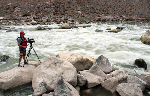 Francisco Kjolseth  |  The Salt Lake Tribune KUED videographer Gary Turnier sets up a shot along one of the rapids in Cataract Canyon in July 2012, during a production piece on river rafting for an upcoming bucket list series on some of Utah's must-do's.