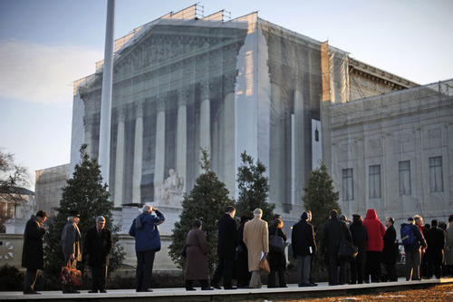 People line up for entrance into the Supreme Court in Washington, Tuesday, March 26, 2013, where the court will hear arguments on California's voter approved ban on same-sex marriage, Proposition 8. (AP Photo/Pablo Martinez Monsivais)
