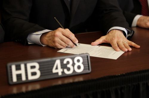 FILE - In this March 1, 2012 file photo, Maryland Gov. Martin O'Malley signs the Civil Marriage Protection Act in Annapolis, Md., becomingthe eighth state to legalize same-sex unions. On Tuesday, the US Supreme Court will begin hearing two days of cases involving gay marriage. (AP Photo/Patrick Semansky, File)