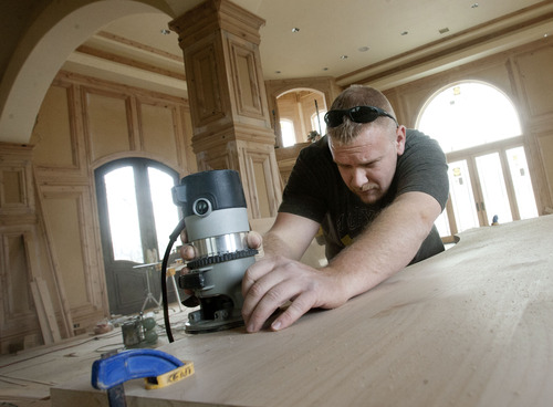 "Steve Griffin | The Salt Lake Tribune Contractor, Benjamin Thompson, works on the finish woodwork, on a home project in Bluffdale, Utah Thursday March 7, 2013. The state has been putting more contractors on probation and revoking licenses because of financial issues. Thompson has had some personal credit problems, but says the business side of his life is clean. Now he's on probation as a ""qualifier."""