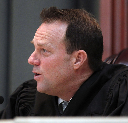 Al Hartmann  |  The Salt Lake Tribune Utah Supreme Court Justice Thomas Lee questions lawyers' arguments in the court Tuesday March 26 in an appeal by Christopher Carlton, an Iraqi vet and Pennsylvania resident, who believes he was wrongly denied the opportunity to intervene when his daughter was placed for adoption in Utah.