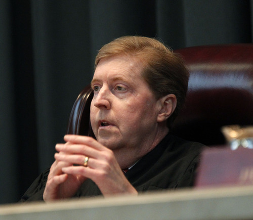 Al Hartmann  |  The Salt Lake Tribune Utah Supreme Court Chief Justice Matthew Durrant listens to lawyers arguments in the court Tuesday March 26 in an appeal by Christopher Carlton, an Iraqi vet and Pennsylvania resident, who believes he was wrongly denied the opportunity to intervene when his daughter was placed for adoption in Utah.