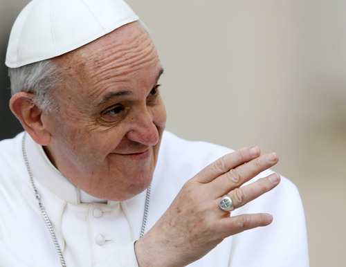 Pope Francis' ring is seen as he delivers his blessing as he is driven through the crowd during his general audience, in St. Peter's Square, at the Vatican, Wednesday, March 27, 2013. (AP Photo/Andrew Medichini)