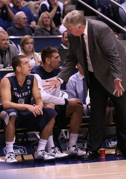 Leah Hogsten     The Salt Lake Tribune Utah State Aggies head coach Stew Morrill has words with Utah State Aggies guard/forward Spencer Butterfield (21) after a foul. Brigham Young University Cougars defeated Utah State University Aggies 70-68 in Provo, February 19, 2013.