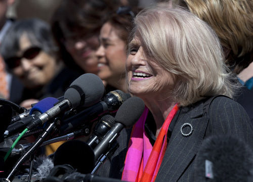 Plaintiff Edith Windsor  of New York, speaks to reporters in Washington, Wednesday, March 27, 2013, after the Supreme Court heard arguments on the Defense of Marriage Act (DOMA) case. The U.S. Supreme Court, in the second day of gay marriage cases, turned Wednesday to a constitutional challenge to the federal law that prevents legally married gay Americans from collecting federal benefits generally available to straight married couples. (AP Photo/Carolyn Kaster)