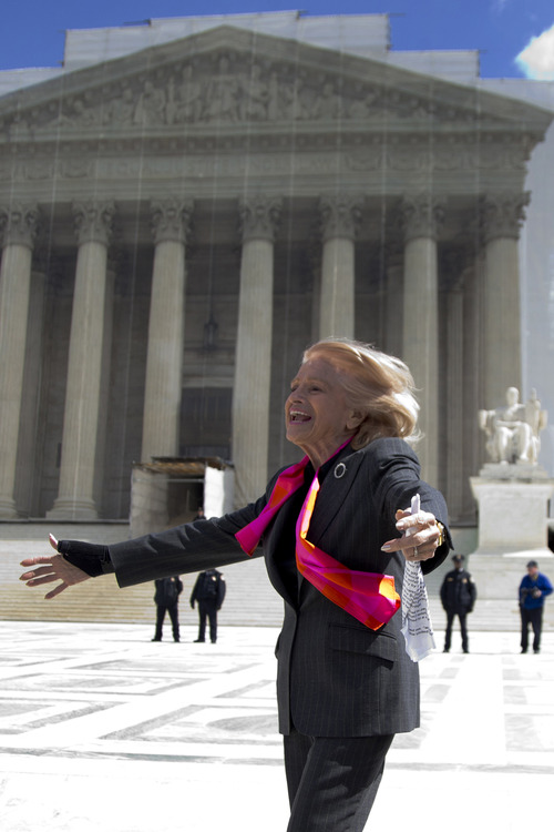 Plaintiff Edith Windsor of New York, reacts as she looks toward supporters in front of the Supreme Court in Washington, Wednesday, March 27, 2013, after the court heard arguments on the Defense Against Marriage Act (DOMA). The U.S. Supreme Court, in the second day of gay marriage cases, turned Wednesday to a constitutional challenge to the federal law that prevents legally married gay Americans from collecting federal benefits generally available to straight married couples.  (AP Photo/Carolyn Kaster)