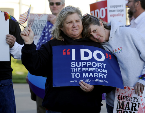 Kim Roberts, left,  and her partner Lisa Mayes of Benicia, Calif. participate in a marriage equality rally on Tuesday, March 26, 2013 at the Solano County Government Center in Fairfield before the Supreme Court hears arguments concerning the Defense of Marriage Act after it heard arguments contesting the constitutionality of the California's Proposition 8 on Tuesday. (AP Photo/The Reporter, Joel Rosenbaum)MANDATORY CREDIT