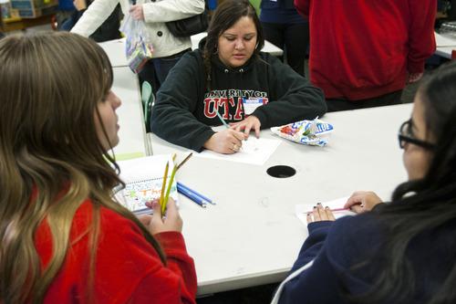 Chris Detrick  |  The Salt Lake Tribune Volunteer Gabby Ehrler works with students Genice Nielsen, left, and Julie Allbor during the Go Girlz after school program at Bryant Middle School Tuesday March 26, 2013.