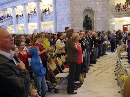 "Steve Griffin | The Salt Lake Tribune   Attendees sing the National Anthem during the Celebration of Marriage event, hosted by Alan and Suzanne Osmond, at the Utah State Capitol in Salt Lake City, Utah Tuesday March 26, 2013. The Celebration of Marriage event Coincides with Prop 8 oral arguments before The US Supreme Court.  A coalition of pro-family Utah organizations sponsored the event.  ""My wife Suzanne and I are so pleased to be a part of the Celebration of Marriage,"" said Alan Osmond. ""Every child deserves the chance to be raised in a home with a mom and dad. Though that's not always possible, it is the ideal society should strive for and promote because of the unparalleled good it does for our kids, families and communities."""