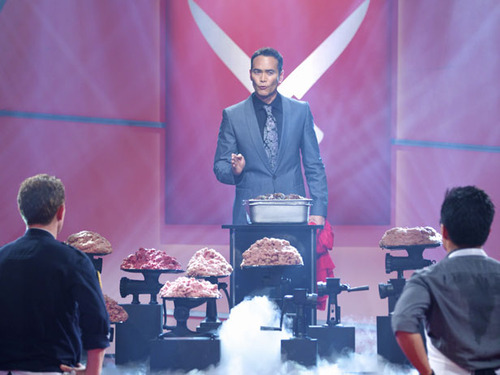 "Food Network Photo  The Chairman, center, reveals the secret ingredient -- ground beef -- to Iron Chef Bobby Flay and Utah chef Viet Pham on Sunday night's episode of ""Iron Chef America."""