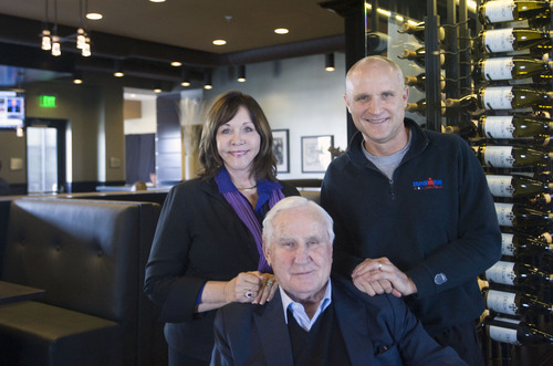 Kim Raff  |  The Salt Lake Tribune (from left) Mary Anne, Don, and Dave Shula are photographed in Shula's 347 Grill in the newly constructed Embassy Suites in West Valley City. The hotel is a cornerstone of the city's Fairbourne Station. Don Shula is a Hall of Fame NFL coach and the restaurant's namesake. His wife, Mary Anne, is CEO of the restaurant company and his son, Dave, is president.