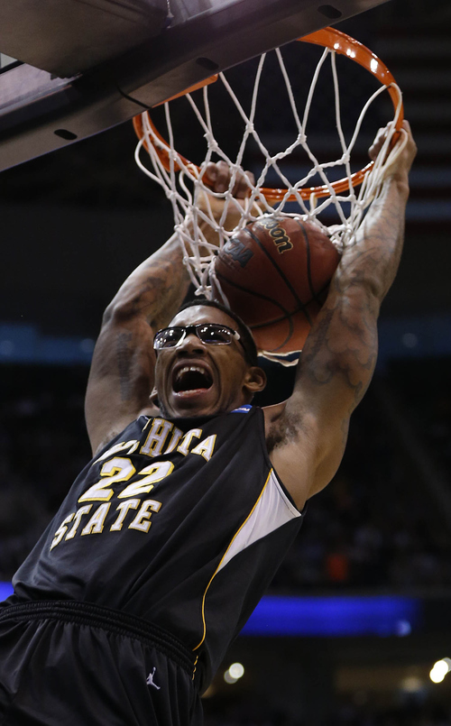 Trent Nelson  |  The Salt Lake Tribune  Wichita State Shockers forward Carl Hall (22) dunks as the Bulldogs face the Shockers in the NCAA tournament at EnergySolutions Arena on Saturday, March 23, 2013.