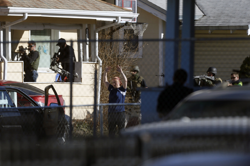 Chris Detrick  |  The Salt Lake Tribune Law enforcement officers take a suspect into custody near the scene of a shooting at 1159 S. Foulger Street Tuesday March 19, 2013. The shooting occurred as members of the Joint Criminal Apprehension Team surrounded a home in the area of 1100 South between State and Main streets.