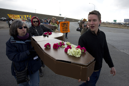 Lennie Mahler  |  The Salt Lake Tribune Will Munger leads protesters in a march to the gate of the Chevron oil refinery north of downtown Salt Lake City to protest oil extraction from tar sands. Protesters voiced concerns damage to the environment, wildlife, and public health. Saturday, March 23, 2013.