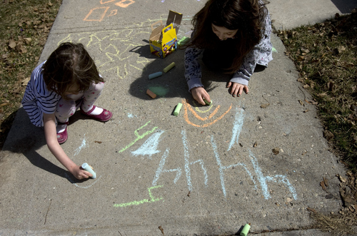 Kim Raff  |  The Salt Lake Tribune On a warm afternoon, neighbors (left) Clare Scarbrough and Abby Sagron color with chalk on the sidewalk outside of their homes on Emerson Avenue in Salt Lake City on March 19, 2013.