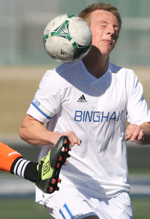 Leah Hogsten  |  The Salt Lake Tribune Bingham's #11 is crowded on a header from a Murray player's foot. Bingham High School boys soccer team defeated Murray High School 1-0, Monday, March 19, 2013.