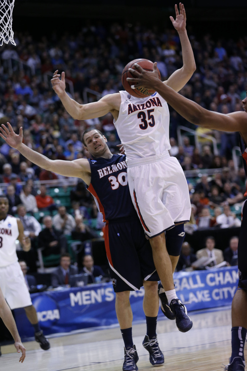 Chris Detrick  |  The Salt Lake Tribune  Arizona Wildcats center Kaleb Tarczewski (35) loses control of the ball as he is defended by Belmont Bruins forward Trevor Noack (30) as the Wildcats face the Bruins in the NCAA tournament at EnergySolutions Arena on Thursday, March 21, 2013.