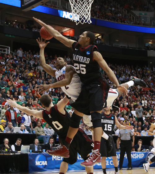 Scott Sommerdorf  |  The Salt Lake Tribune  Harvard Crimson center Kenyatta Smith (25) blocks a shot Arizona Wildcats guard Mark Lyons (2) as the Wildcats face the Crimson in the NCAA tournament at EnergySolutions Arena on Saturday, March 23, 2013.