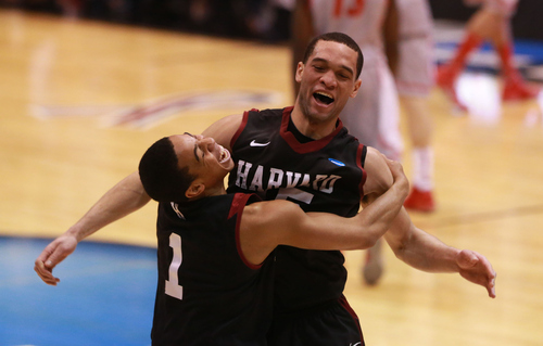 Scott Sommerdorf  |  The Salt Lake Tribune  Harvard Crimson guard Siyani Chambers (1) and guard Christian Webster (15) celebrate after the Crimson beat New Mexico in the NCAA tournament at EnergySolutions Arena on Thursday, March 21, 2013.