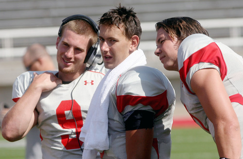 Steve Griffin | The Salt Lake Tribune   Utah quarterback Jordan Wynn, center, stands with Jon Hays and Travis Wilson during a scrimmage Aug. 9, 2012.