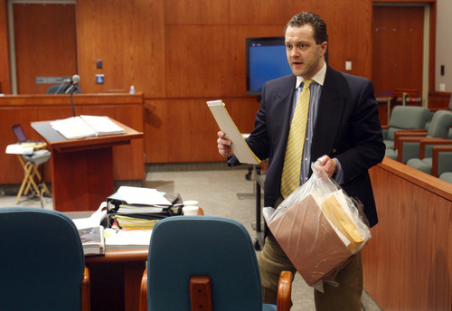 Nathan Sloop carries his bag of notes during recess on the first day of his preliminary hearing Wednesday, March 27, 2013 at 2nd District Court in Farmington, Utah. (NICK SHORT/Standard-Examiner)