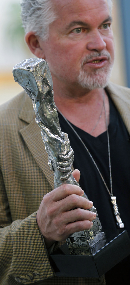 "Al Hartmann  |  The Salt Lake Tribune Sculptor Gary Lee Price unveiled a 15-foot protype of the ""Statue of Responsibility"" in the Losee Center at Utah Valley University Thursday. He holds a small model of the sculpture, planned as a ""bookend"" with the Statue of Liberty. Supporters say the full-size version will be placed at an undisclosed California location."