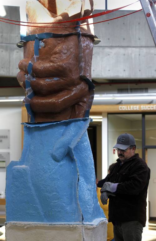 "Al Hartmann  |  The Salt Lake Tribune Artisan Sergio Blanco prepares to remove a bottom section of the working mold for sculptor Gary Lee Price's 15-foot protype of the ""Statue of Responsibility"" in the Losee Center at Utah Valley University Thursday. This model will be cast in stainless steel.  And a future sculpture the same size as the Statue of Liberty will be installed on the West Coast."