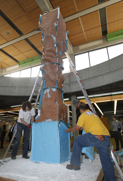 "Al Hartmann  |  The Salt Lake Tribune Artisans for sculptor Gary Lee Price remove sections of the working mold of a 15-foot protype of the ""Statue of Responsibility"" in the Losee Center at Utah Valley University Thursday. This model will be cast in stainless steel. And a future sculpture the same size as the Statue of Liberty will be installed on the West Coast at an undisclosed location."