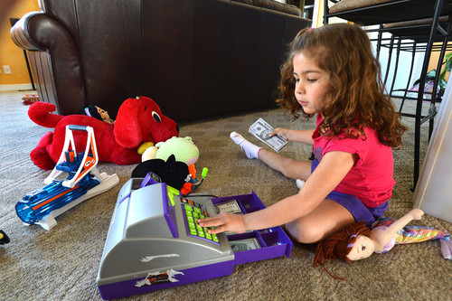 Lilli Ana Dolan, 5, of Pleasant Hill plays with her toys inside her home in Pleasant Hill, Calif., on Thursday, March 21, 2013. (Dan Rosenstrauch/Staff)