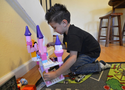 Julian Meija-Blagovic, 4, of Martinez, plays with a Duplo Lego Castle that was given to his parents for their five-month-old daughter  in Martinez, Calif., on Saturday March 23, 2013.  His parents, Jorge Meija and Lisa Blagovic,  are trying to raise their kids with respect and balance of gender. (Dan Rosenstrauch/Staff)